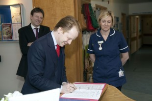 Ben Gummer MP signs in at St Julia's Hospice, Hayle.