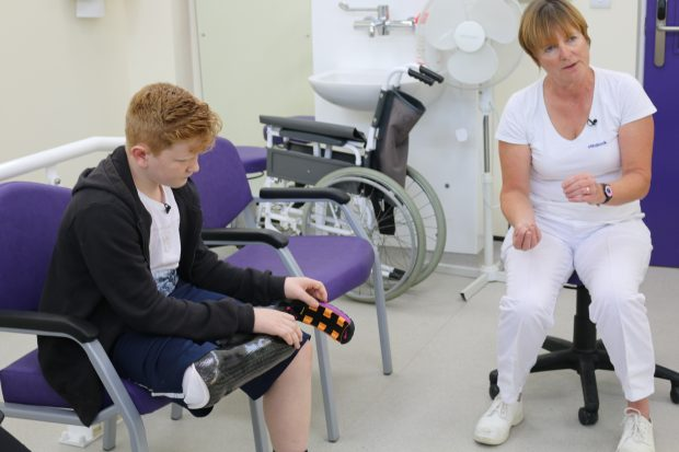 Ben speaking to sports prosthetist, Clare Johnson about his new sports prosthesis.