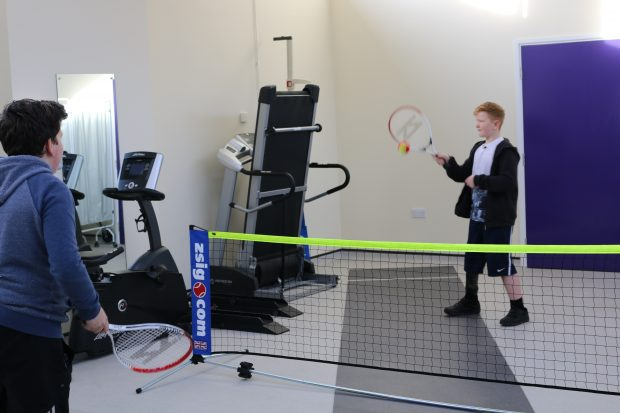 Ben playing tennis at the Brighton Limb Centre with a friend
